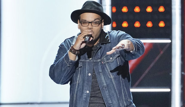 Matthew Johnson performing on the stage of The Voice