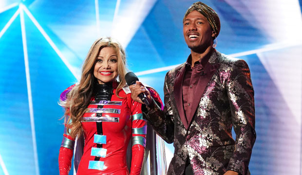 Le Toya Jackson standing on the set of The Masked Singer along with host Nick Cannon