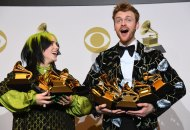 Billie Eilish and Finneas O'Connell hold their awards for Record of the Year, Album of the Year and more in the Winner's Circle at THE 62ND ANNUAL GRAMMY AWARDS